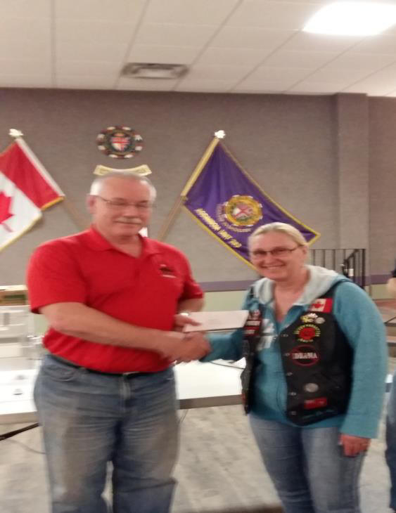 tris service pic donating to Veterans Canada